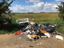 Large fly tipping pile by the roadside