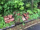 Bricks dumped at side of road